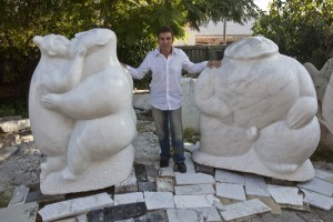 Vince Vozzo with 2 large sculptures